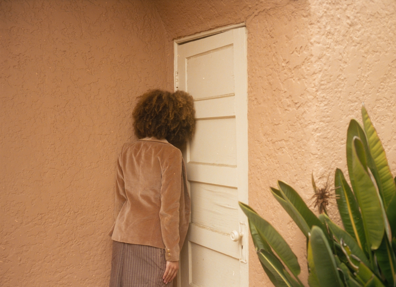 woman banging her head against a wall