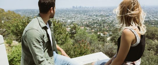 couple looking out over a city view