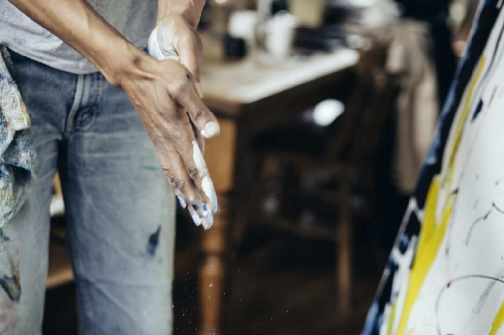 man with paint on his hands